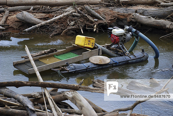 Floating work platform of a gold seeker in Amazonia  Bolivia  South America