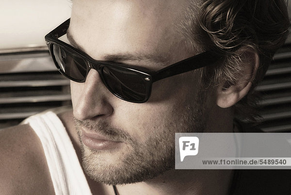 Young man with sunglasses  close up