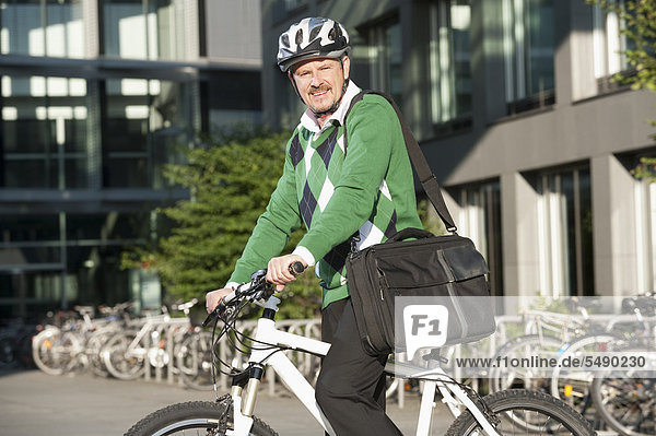 Mature man on bicycle  portrait  smiling