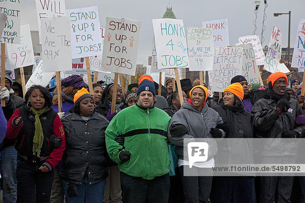 'Supported by members of the Service Employees International Union and the United Auto Workers  members of the ''occupy'' movement block a crumbling bridge to demand passage of President Obama's American Jobs Act  Detroit  Michigan  USA'