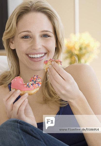 Woman eating Matt Krapfen
