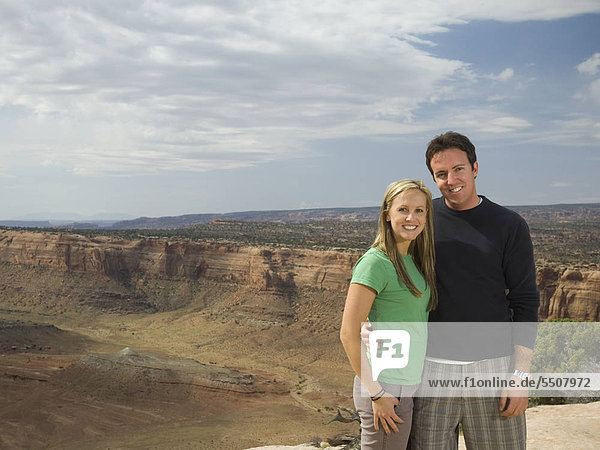 Portrait of couple in front of canyon