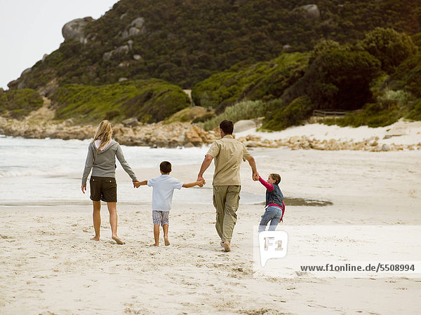 Parents with their children on the beach.