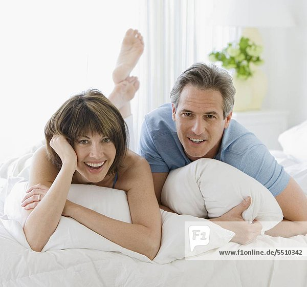 Couple laying on bed