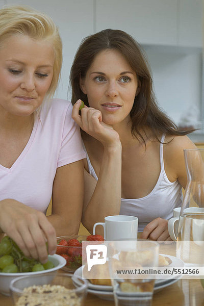 Two women at breakfast table