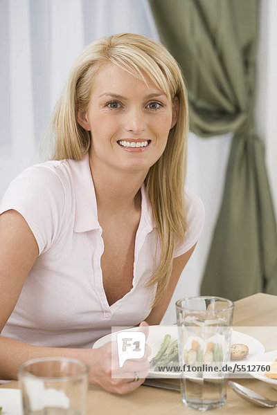 Portrait of woman at dinner table