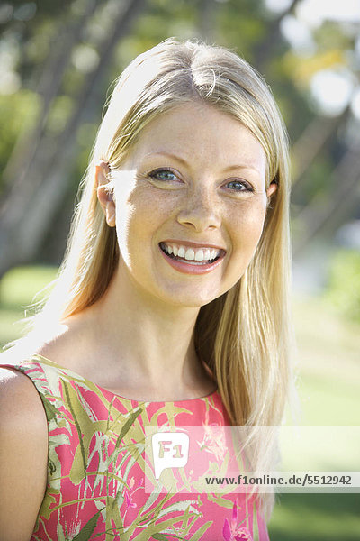 Caucasian Mitte adult Woman smiling at Viewer.