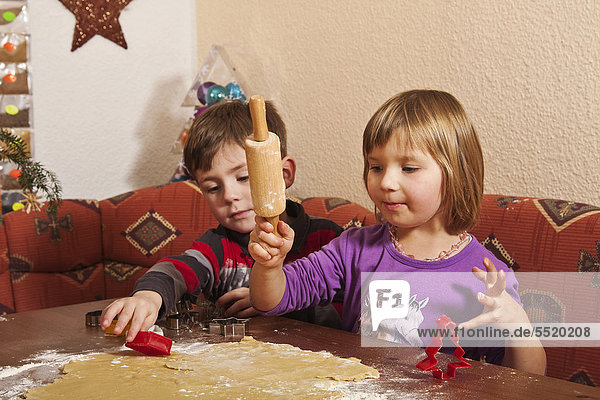 Boy and girl baking biscuits