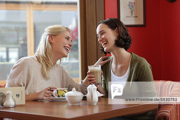 Two girl friends at cafe