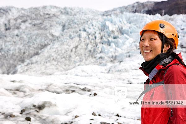 Hiker standing on Fallsjokull glacier