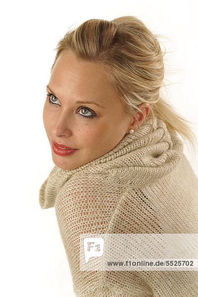 Young woman wearing a knitted sweater  portrait
