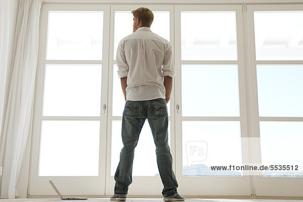 Man looking out window  rear view