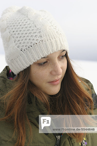 Portrait of a young woman in the snow  Black Forest  Baden-Wuerttemberg  Germany  Europe  PublicGround