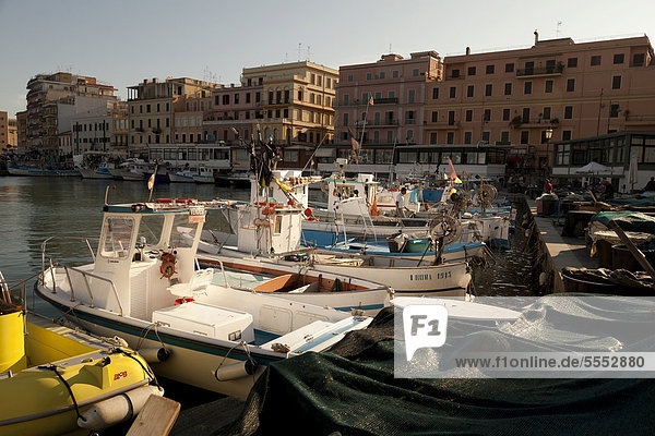 Small fishing boats moored stern first in Anzio harbour  Lazio  Italy  Europe