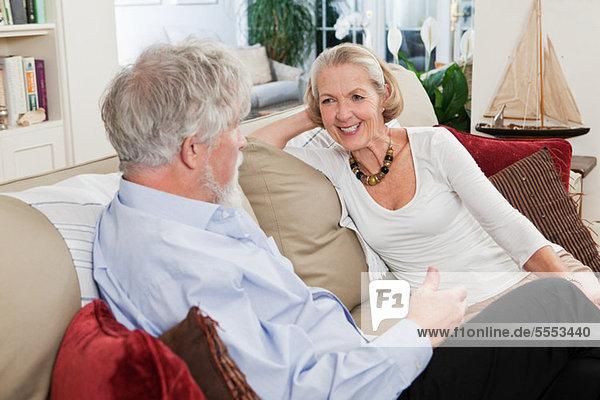 Senior Couple relaxing on sofa