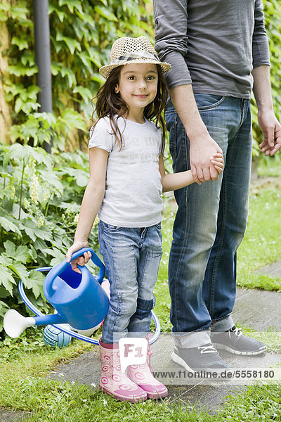 Father and daughter gardening together