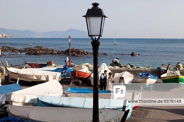 Italy  Liguria  couple on the beach