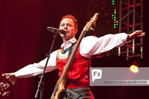 'Markus Unterladstaetter  singer and frontman of the Austrian folk music and pop band ''Die jungen Zillertaler'' performing live at the Schlager Nacht 2012  pop music event  in Lucerne  Switzerland  Europe'