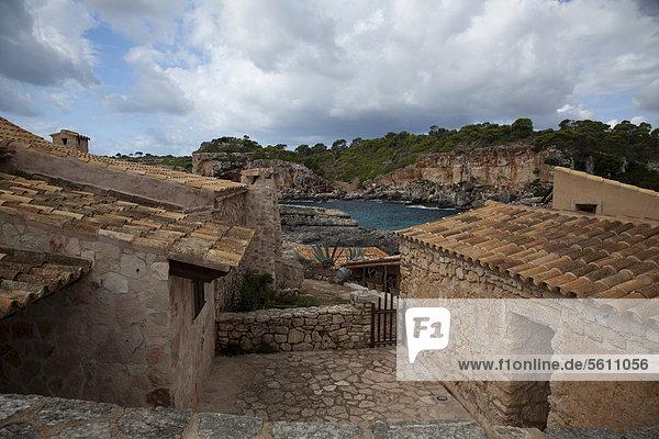 Stone houses  Cala s'Almunia  southeast coast  Majorca  Balearic Islands  Spain  Europe
