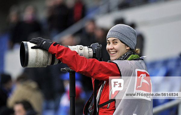Press photographer  sports photographer at work  Rhein-Neckar-Arena  Sinsheim-Hoffenheim  Baden-Wuerttemberg  Germany  Europe