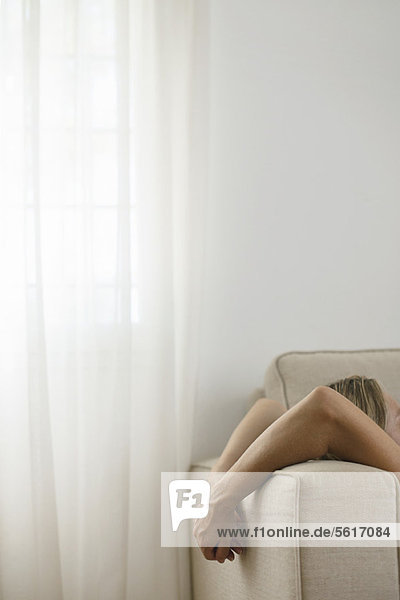 Woman relaxing on sofa  cropped