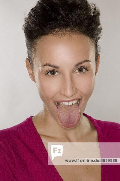 Woman poking tongue out