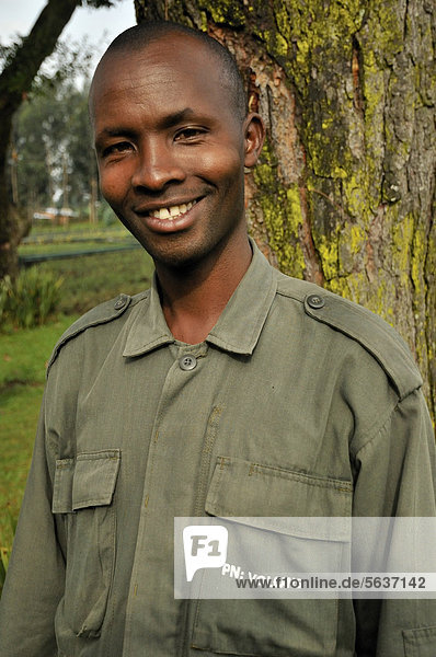 Park guide at the entrance to the Volcanoes National Park  Parc National des Volcans near the village of Kinigi  Rwanda  Africa