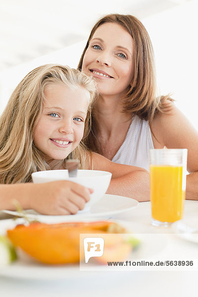 Mother and daughter at breakfast table