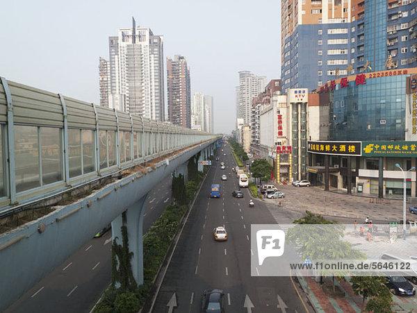 Multiple lane one way street and skyline  Xiamen  China