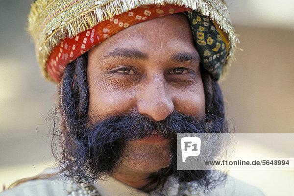 Smiling Rajasthani with beard  Jaipur  Rajasthan  India  Asia