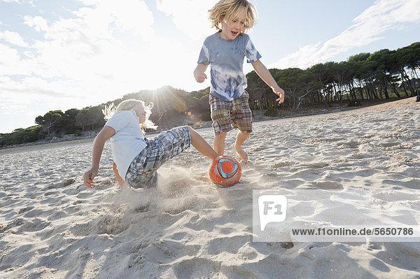 Spain  Mallorca  Children playing soccer on beach