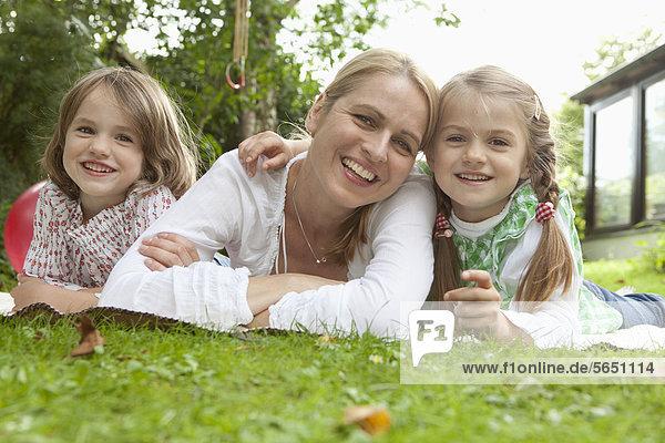Germany  Bavaria  Munich  Family in garden  smiling