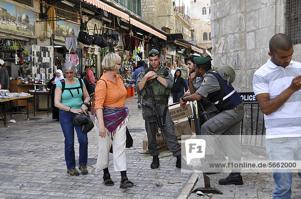 Tourists talking with soldiers  Old City of Jerusalem  Israel  Middle East  Southwest Asia