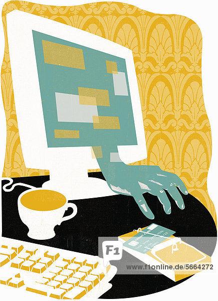 Hand aus einem Computer-Bildschirm greift nach Kreditkarte auf Mausefalle