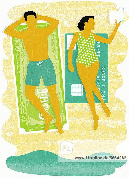 Mann und Frau sonnt sich auf Geldschein und Kreditkarte am Strand