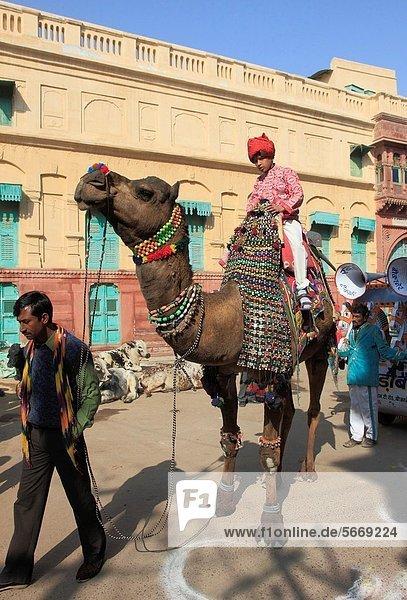 India  Rajasthan  Bikaner  Old City  street scene  procession  people