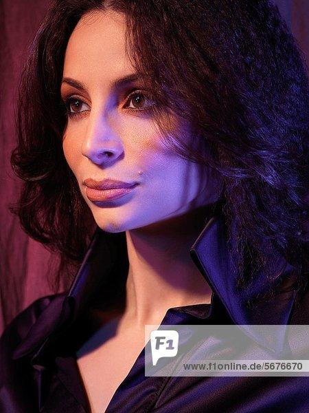 Artistic dramatic portrait of a glamorous young woman with beautiful eyes