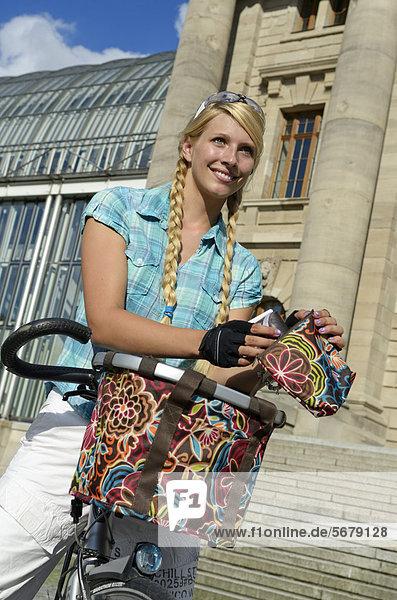 Woman riding a bike to do her shopping