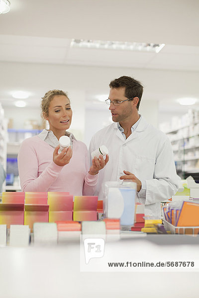 Pharmacist helping patient in store