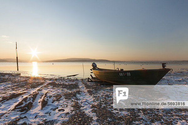 Fishing boat on Lake Constance at sunset in winter  Reichenau Island  Baden-Wuerttemberg  Germany  Europe