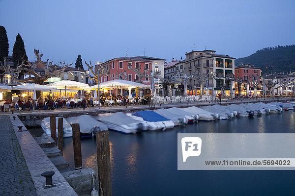 View over the port towards the town at dusk  Garda  Lake Garda  Veneto  Italy  Europe  PublicGround