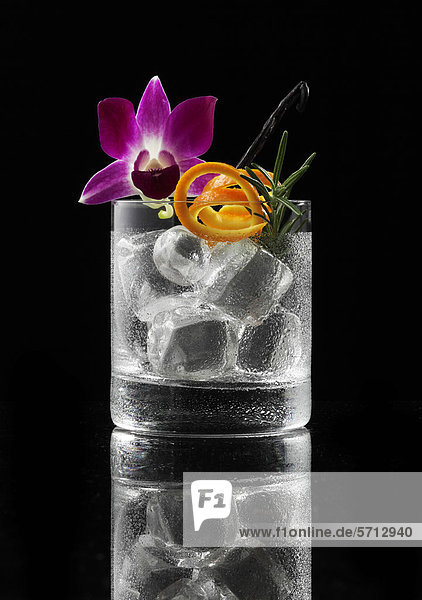 Glass prepared for a cocktail with ice cubes and decorations