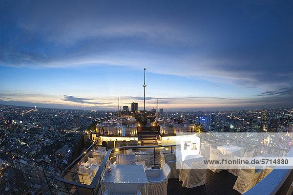 View of the city  Vertigo Bar and Restaurant  roof of the Banyan Tree Hotel  at dusk Bangkok  Thailand  Asia