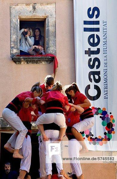 Nens del Vendrell ´Castellers´ building human tower  a Catalan tradition Fira de Santa Teresa  town festival Plaça Vella El Vendrell Tarragona province  Spain