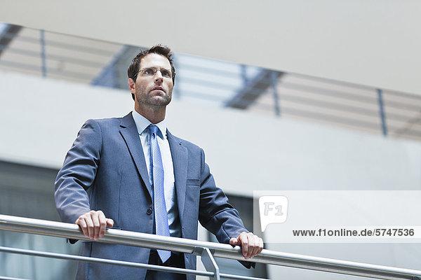 Businessman standing on balcony