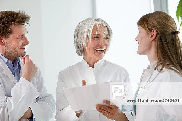 Doctors talking together in hospital