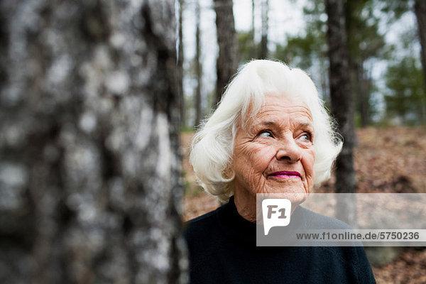 Portrait of senior Woman looking away in Wald Portrait of senior Woman looking away in Wald