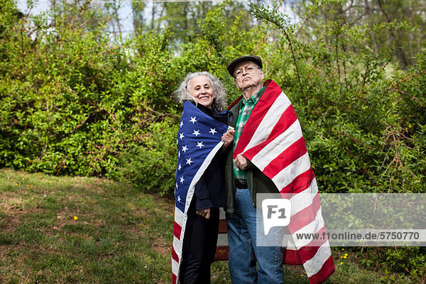 Senior Couple wearing American Flag  portrait