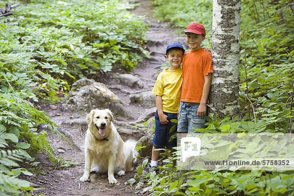 Two young brothers hike along the Bruce Trail at Lion's Head  Ontario  Canada.