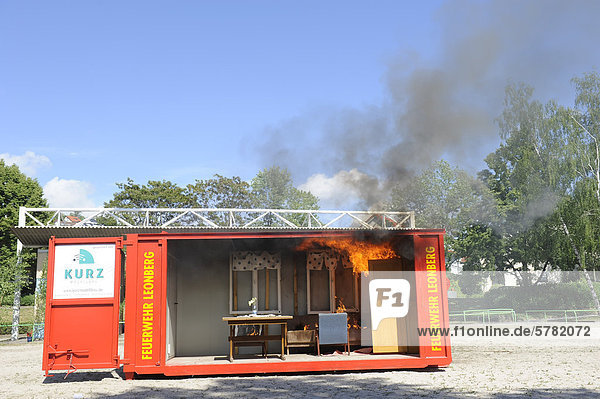 Demonstration of a room fire in a fire-container at the Feuerwehr Leonberg fire brigade  Baden-Wuerttemberg  Germany  Europe